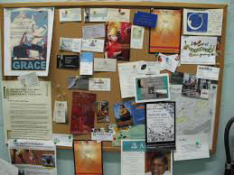 bulletin board with numerous items